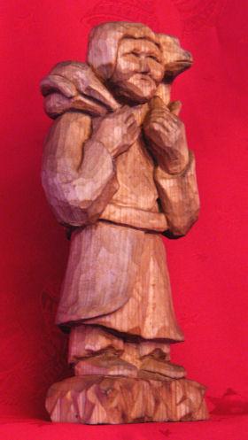 Handgesneden herder met schaap Kerststal